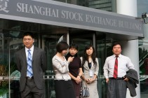 Chinese stock brokers are seen outside t